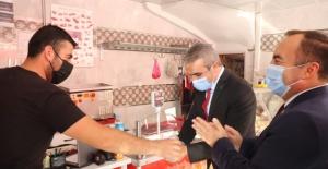 MHP'den esnafa destek ziyareti